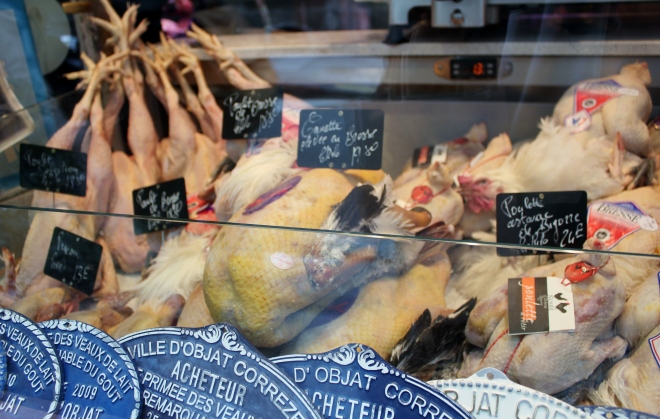 A butchers window in unspoiled Ile Saint-Louis, Paris